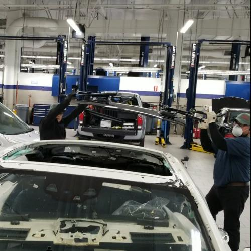 Arturo Orlando installing a panoramic roof glass at Keyes Mercedes
