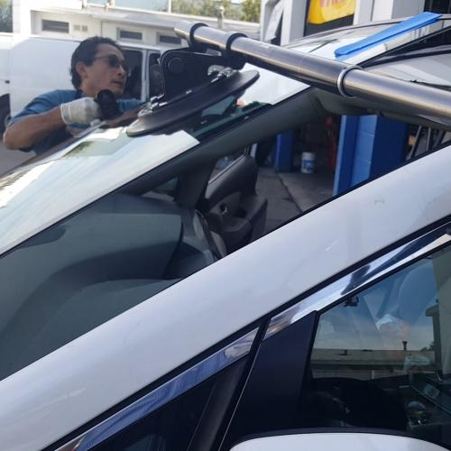 Arturo doing a windshield on a Honda Odessey