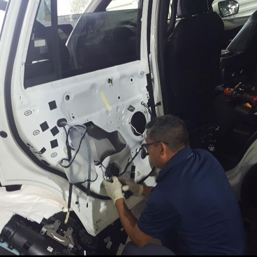 Felipe fixing a side window at National Rent a Car Burbank Airport