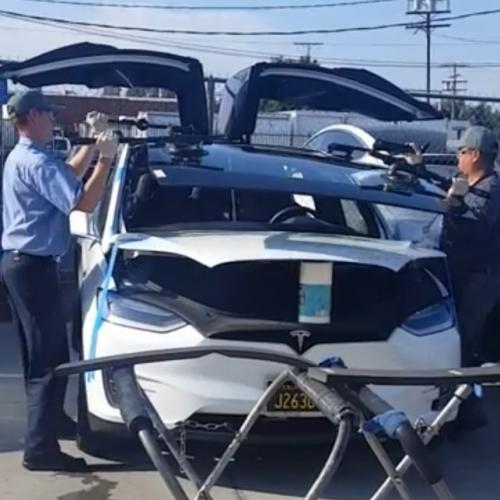 Gus doing a windshield on a 2019 Tesla Model X at Tesla Van Nuys
