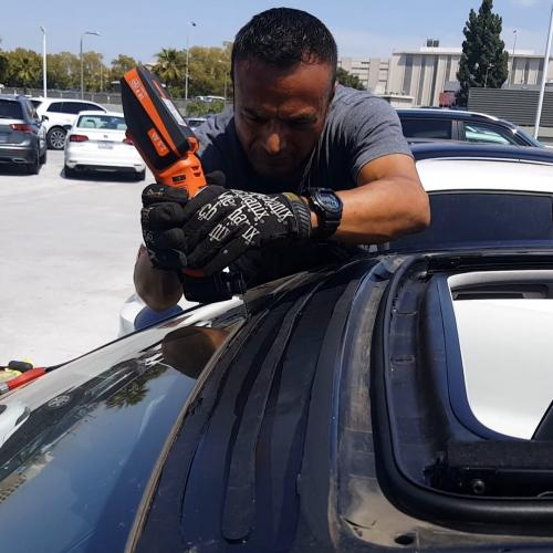 Jose doing a roof glass at Volkswagen DTLA
