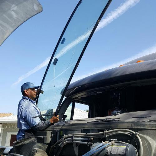 Tony, doing a windshield on a Peterbilt